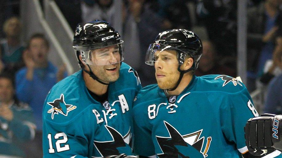 15972925-Coyotes Sharks Hockey