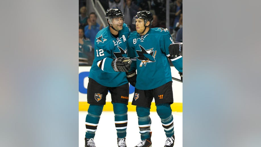 15972925-Coyotes Sharks Hockey