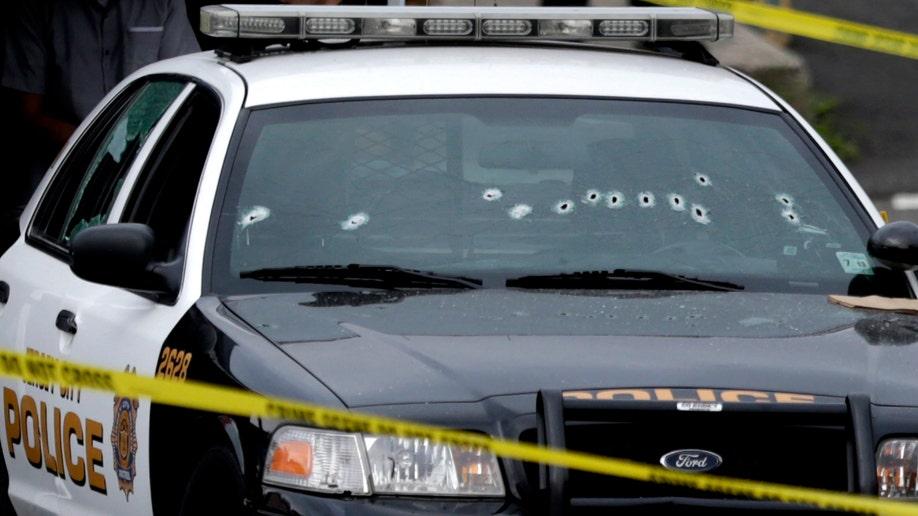 4f8ff3c8-Police Officer Killed