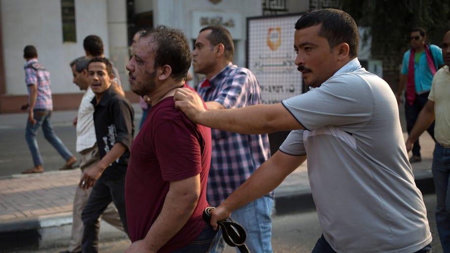 c03b641d-Mideast Egypt Prosecuting The Brotherhood