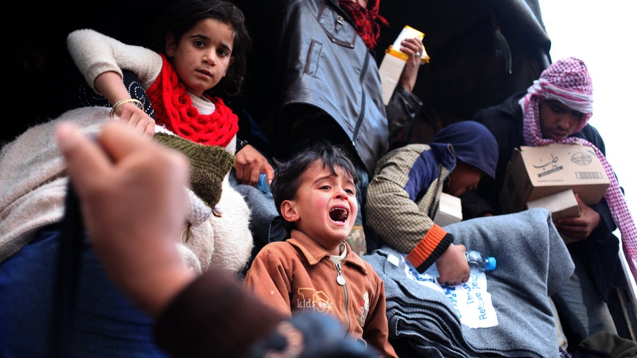 5af2daed-APTOPIX Mideast Jordan Syrian Refugees