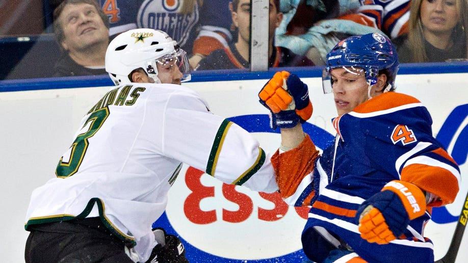 5876b731-Stars Oilers Hockey