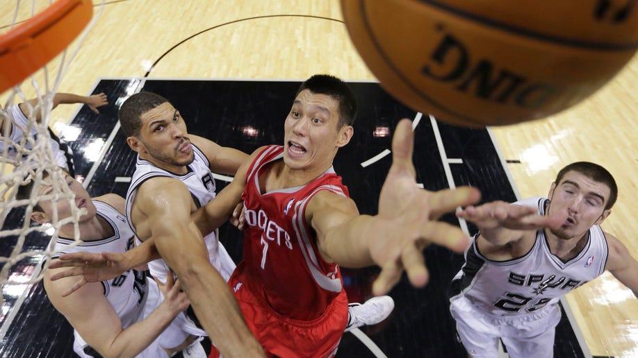 13e28b19-Rockets Spurs Basketball