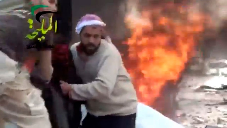 0c0dca14-Mideast Syria