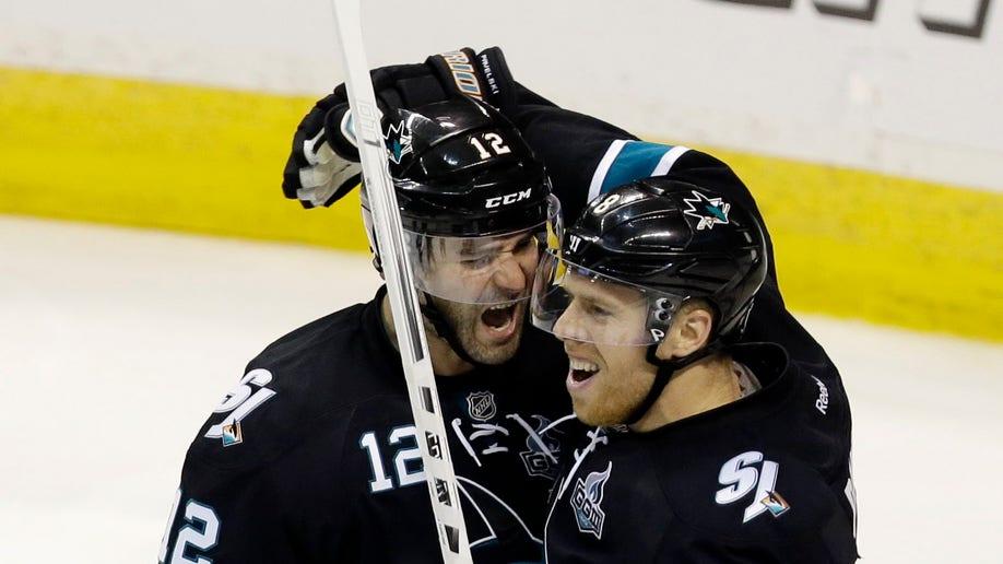 5978c5e3-Canucks Sharks Hockey