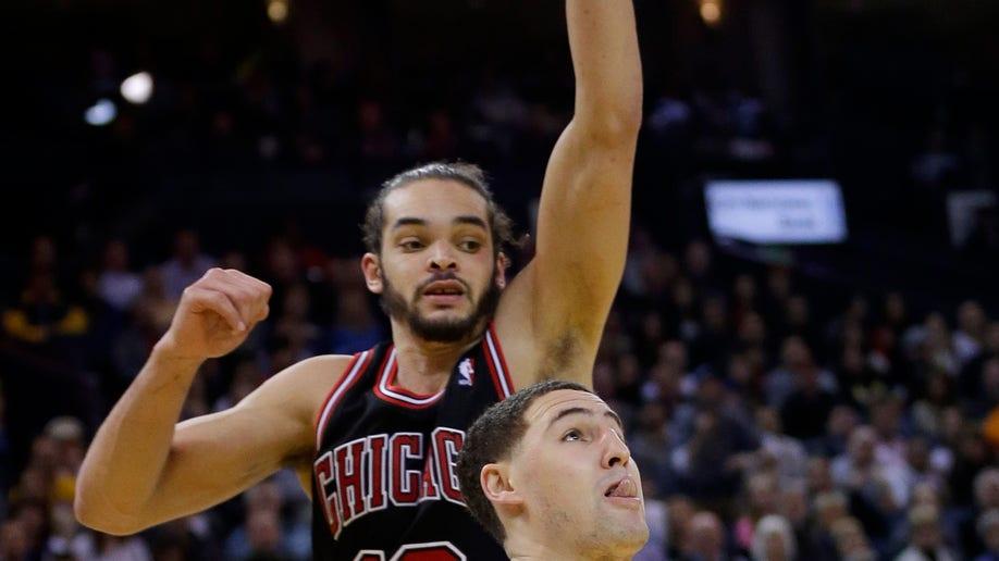 2dedc857-Bulls Warriors Basketball
