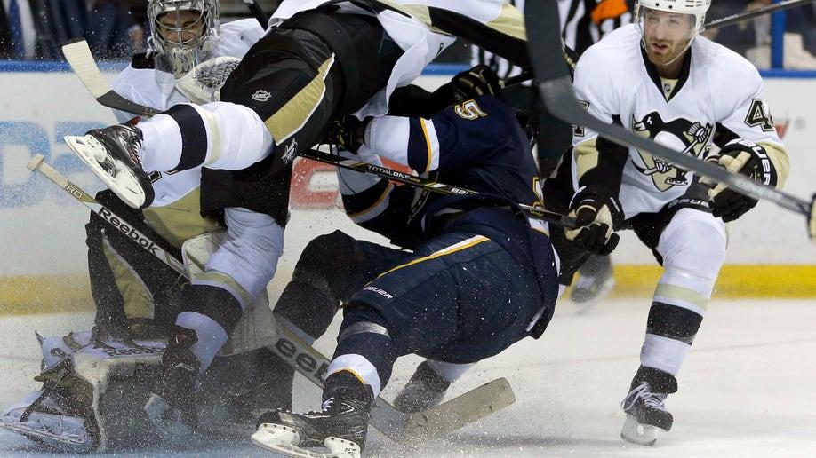 APTOPIX Penguins Blues Hockey
