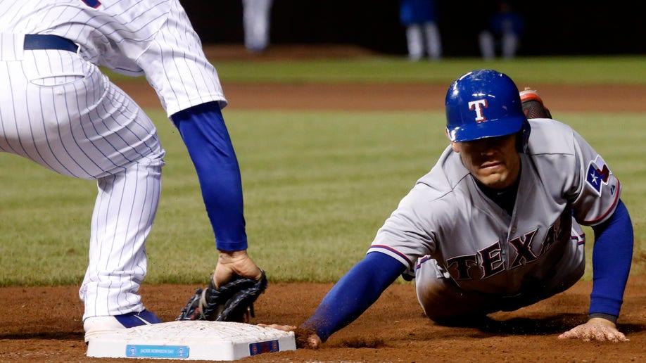 2a221358-Rangers Cubs Baseball