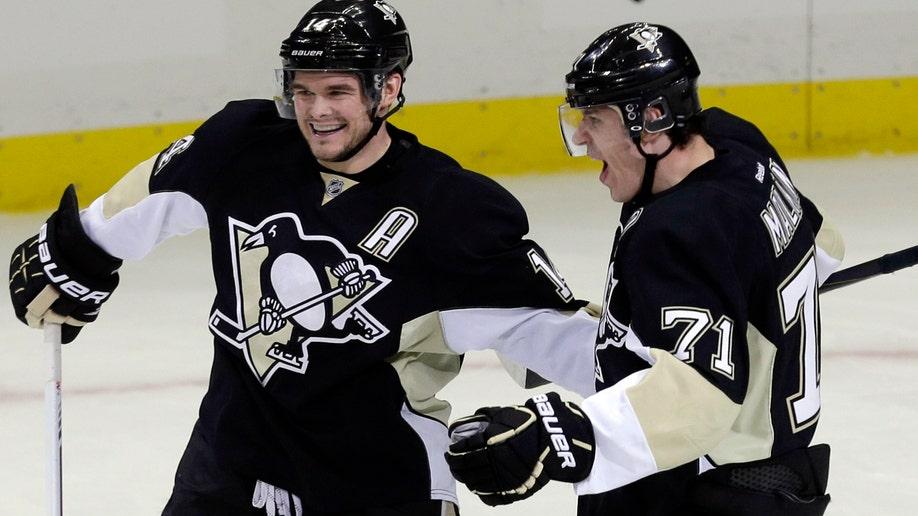 60802f61-Senators Penguins Hockey