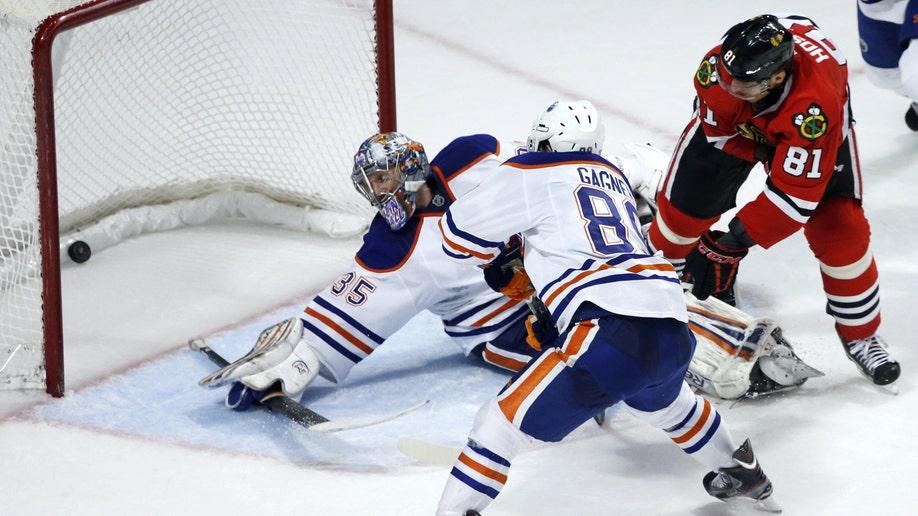 a1c9d37e-Oilers Blackhawks Hockey