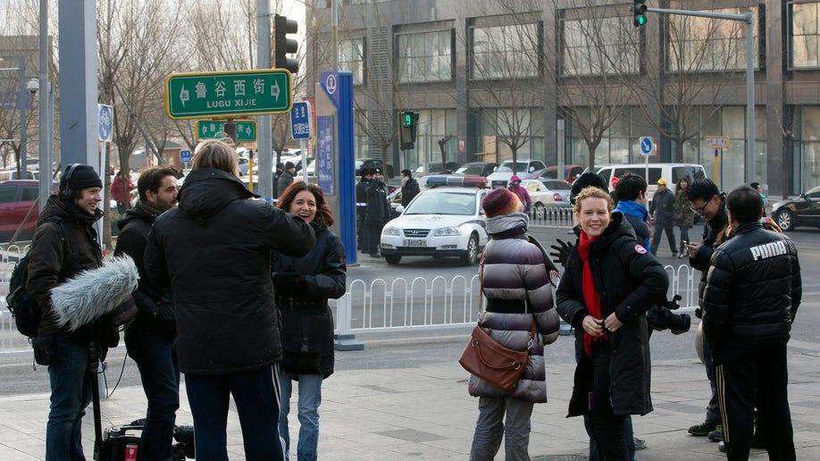 987cec49-China Journalists Under Pressure