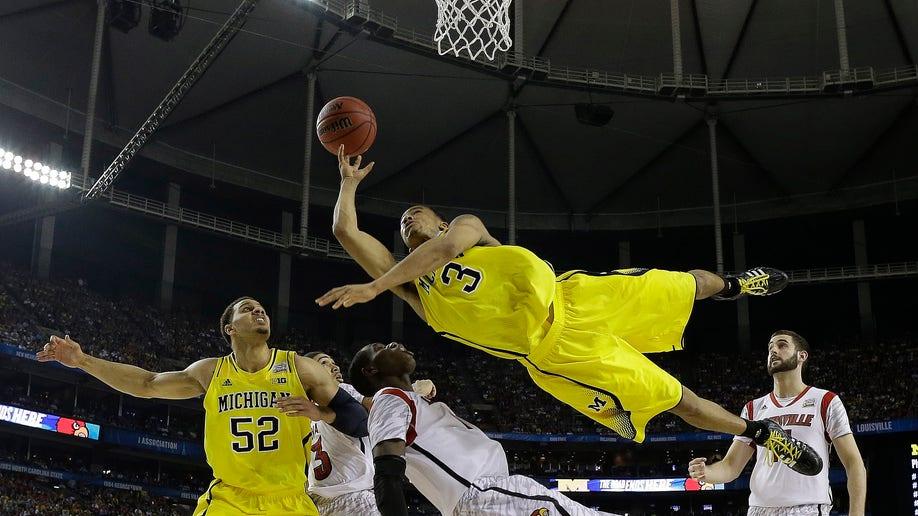 64325020-APTOPIX NCAA Final Four Michigan Louisville Basketball