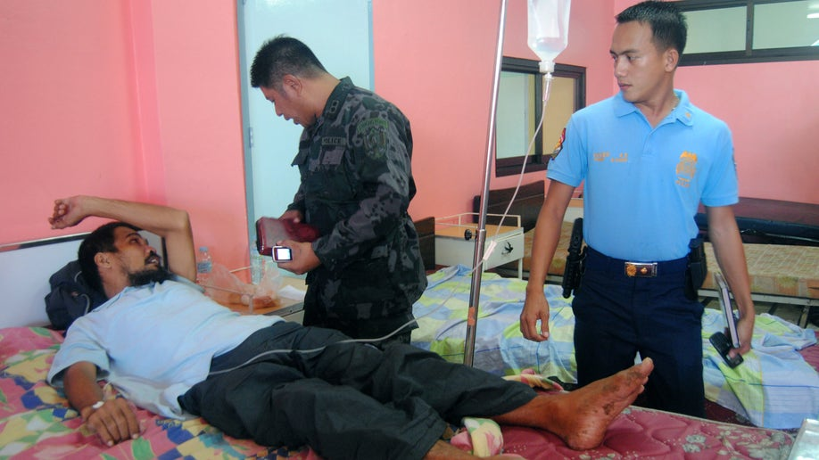 5139cf26-Philippines Hostages Freed