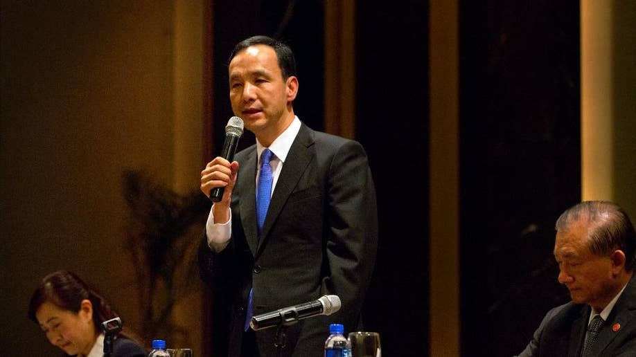Taiwan ruling party leader affirms eventual reunification ...