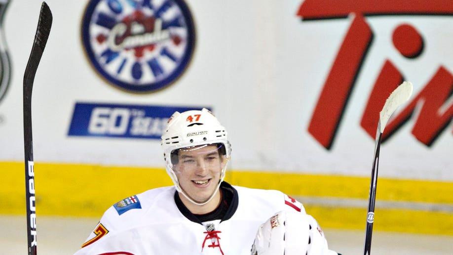 284b5529-Flames Oilers Hockey