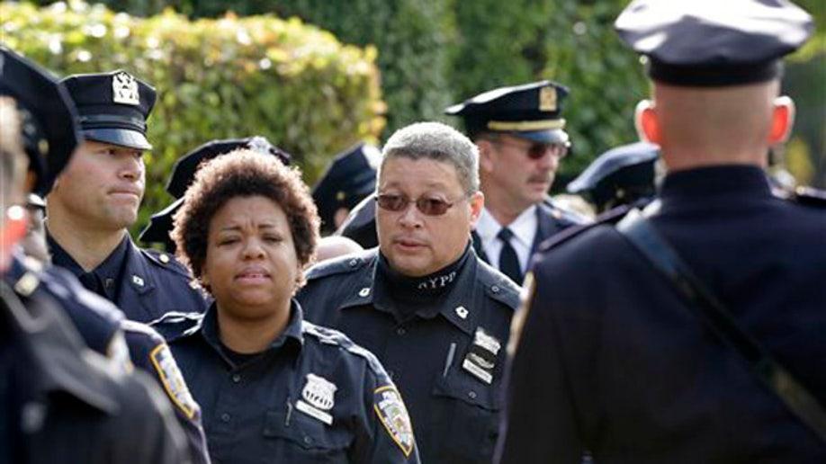 26a53c05-Manhattan Officer Shot
