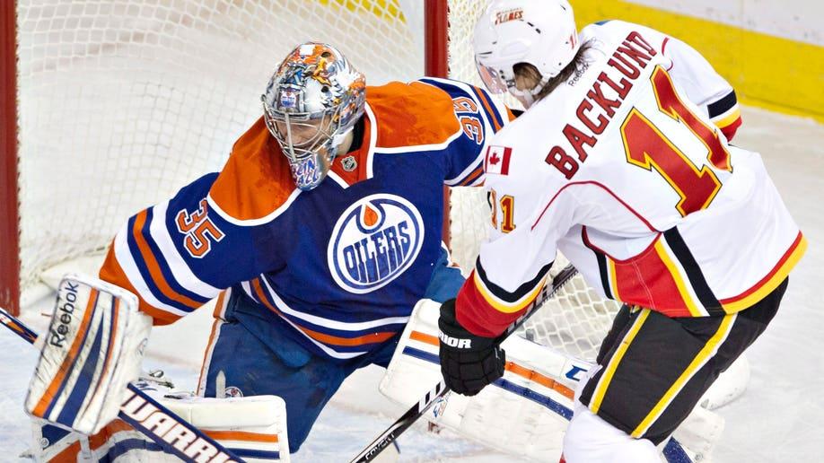 e07bb143-Flames Oilers Hockey