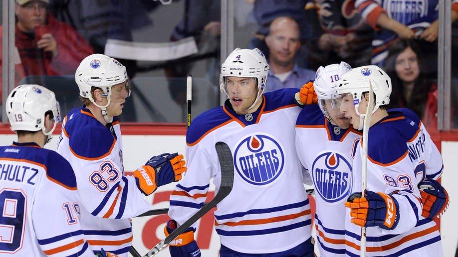 776c2f26-Oilers Flames Hockey