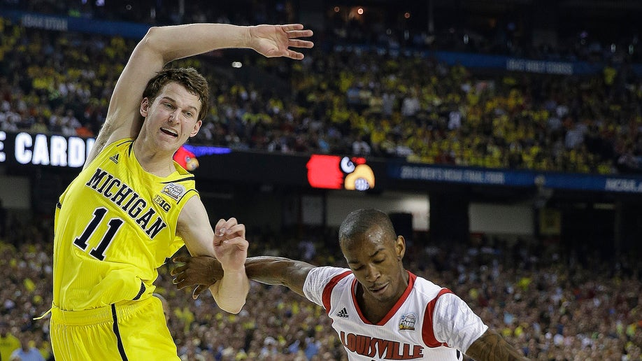 1f824c21-NCAA Final Four Michigan Louisville Basketball