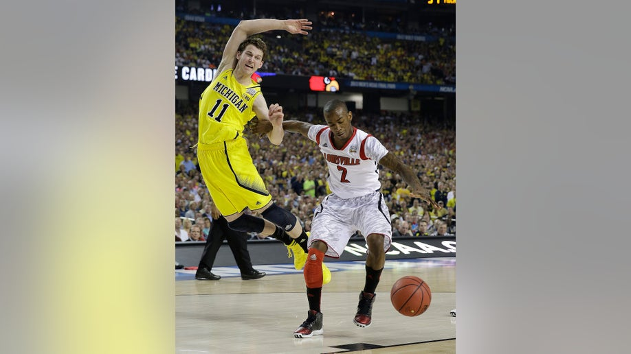 1f824c21-NCAA Final Four Michigan Louisville Basketball