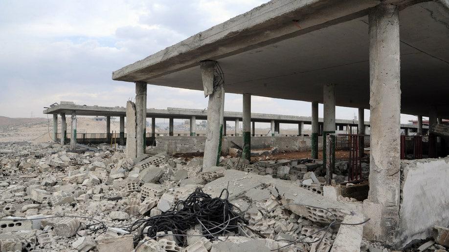 6a300f6b-Mideast Syria Israel