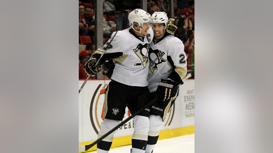 9f28a948-Penguins Red Wings Hockey