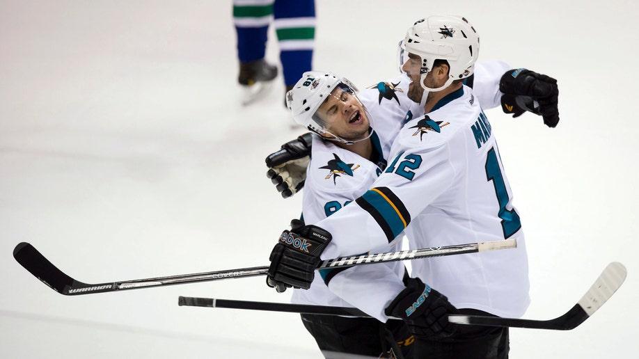 354715b3-Sharks Canucks Hockey
