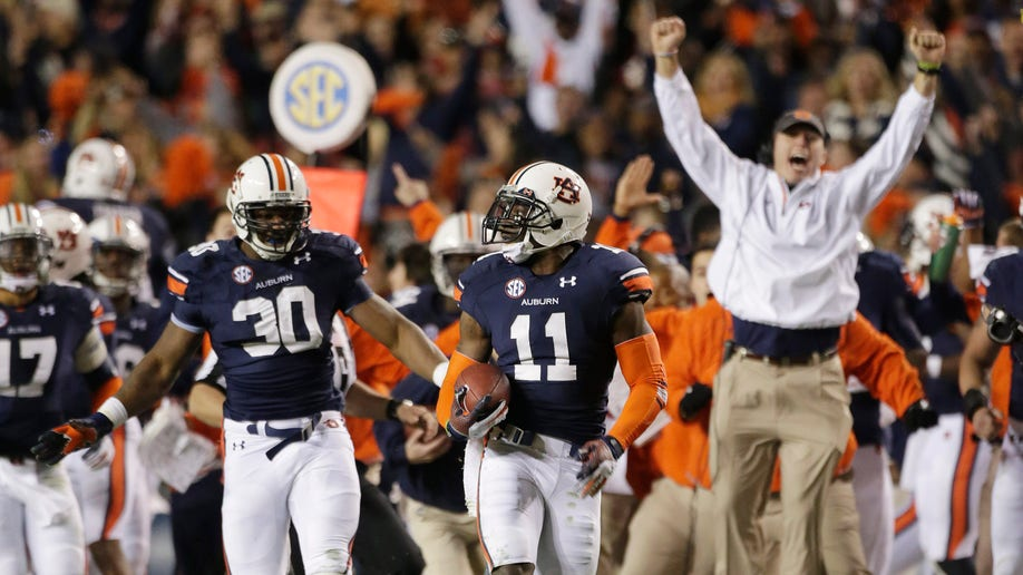 APTOPIX Alabama Auburn Football