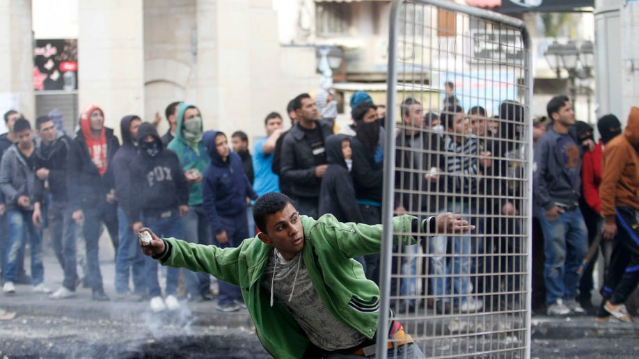 f0b69e34-Mideast Israel Palestinians