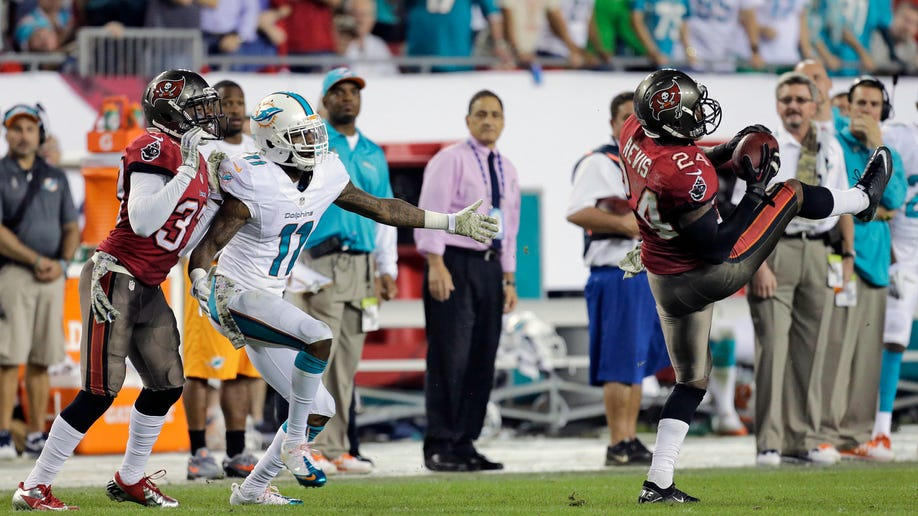 64f9f1d0-Dolphins Buccaneers Football
