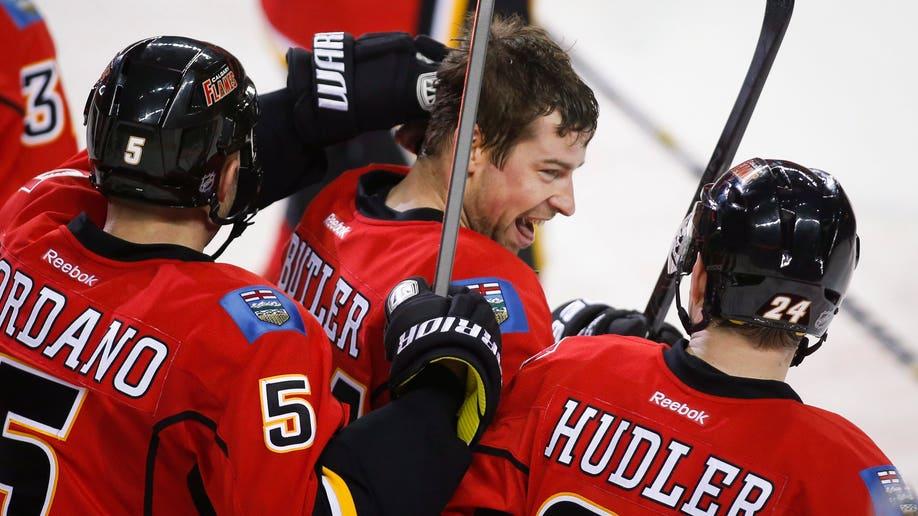 970e3079-Hurricanes Flames Hockey