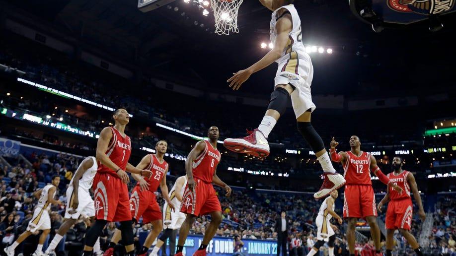 516f8fa1-Rockets Pelicans Basketball