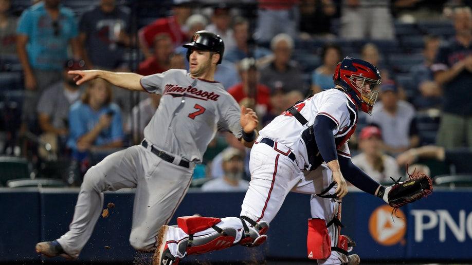 52c7230e-Twins Braves Baseball
