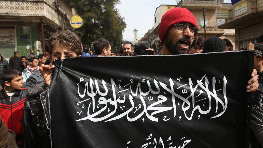 c31cc3f2-Mideast Syria Militant Leader