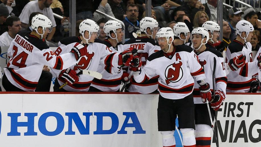 13f81285-Devils Penguins Hockey