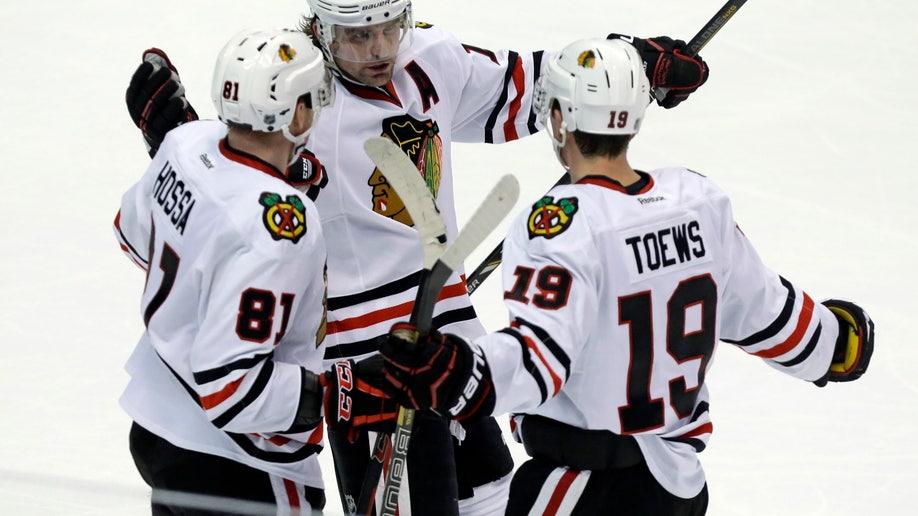 82eb9103-Blackhawks Ducks Hockey