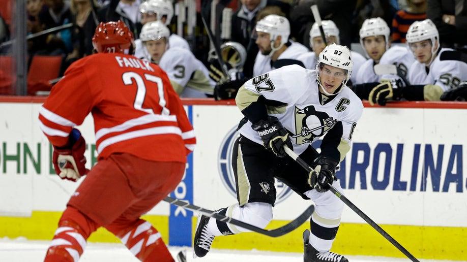 9c4c05c9-Penguins Hurricanes Hockey
