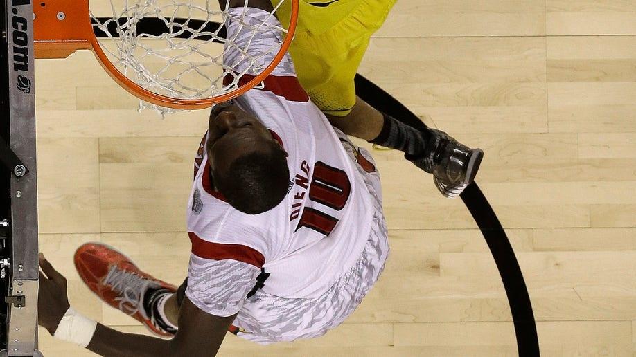 be035d15-NCAA Final Four Michigan Louisville Basketball
