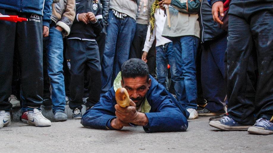 cb5ff14a-APTOPIX Tunisia Protest