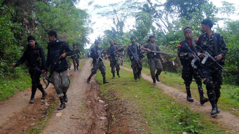 65189cf8-Philippines Warring Rebels