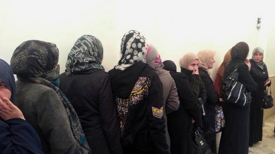 2e723854-Syria Prisoner Exchange