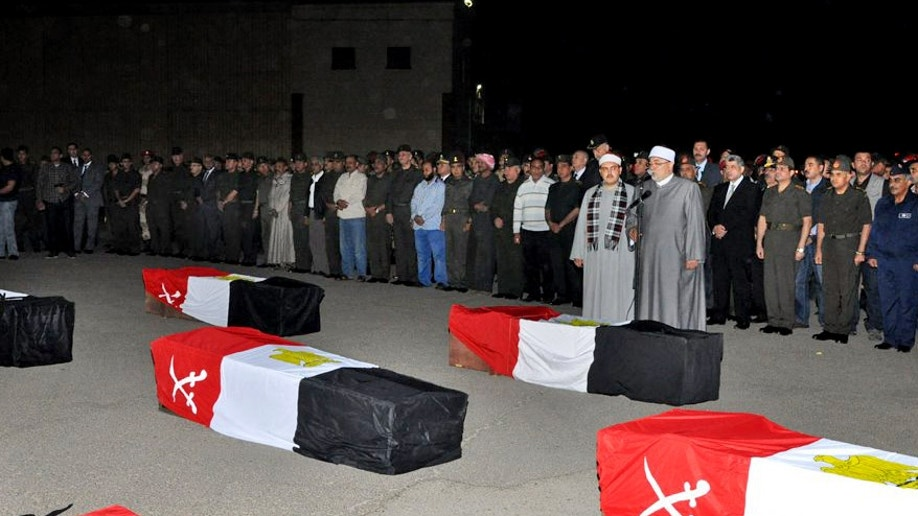 d0e03ccf-Mideast Egypt Country in Mourning
