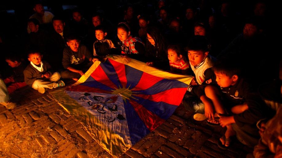4224160c-Nepal Tibetan Protestor