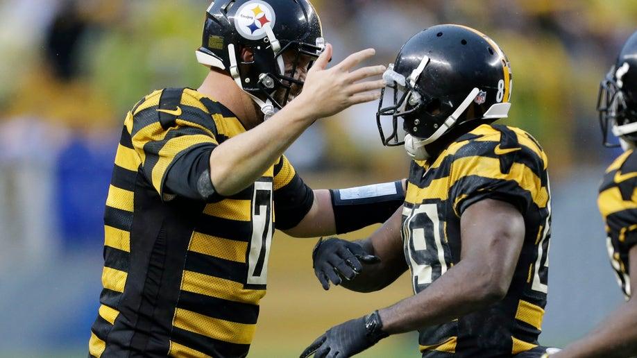 365ccbaf-Lions Steelers Football