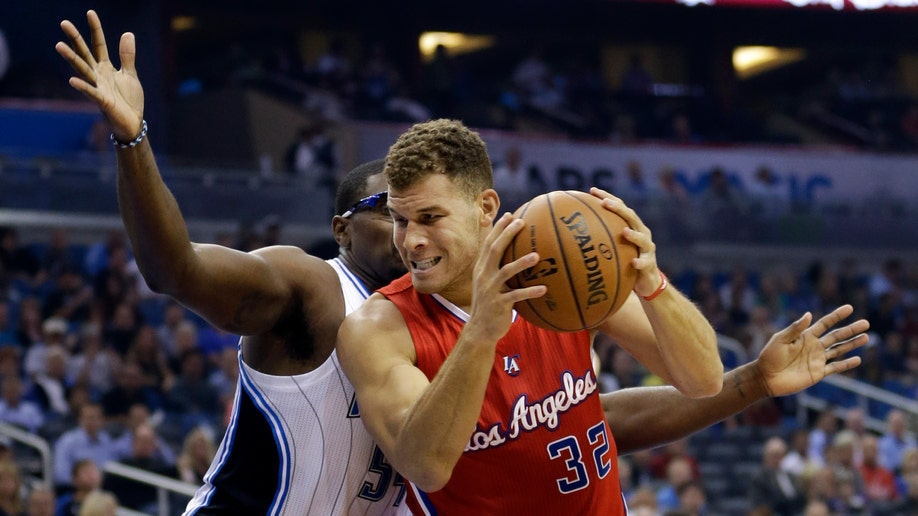 959df9ce-Clippers Magic Basketball