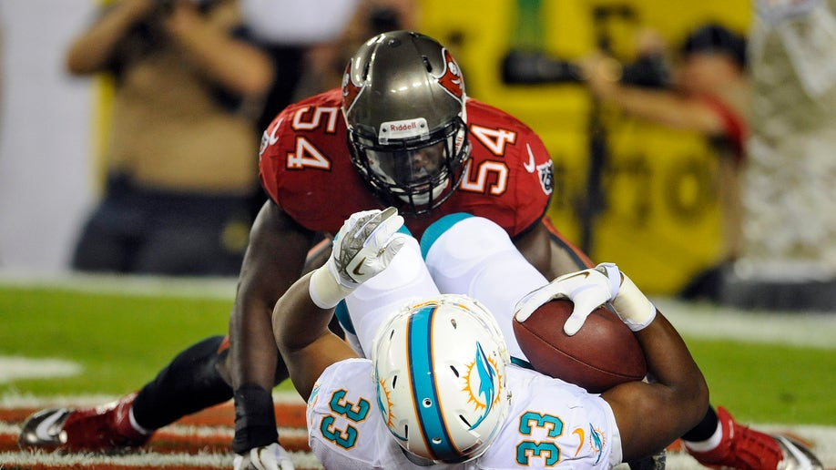 a5711c62-Dolphins Buccaneers Football