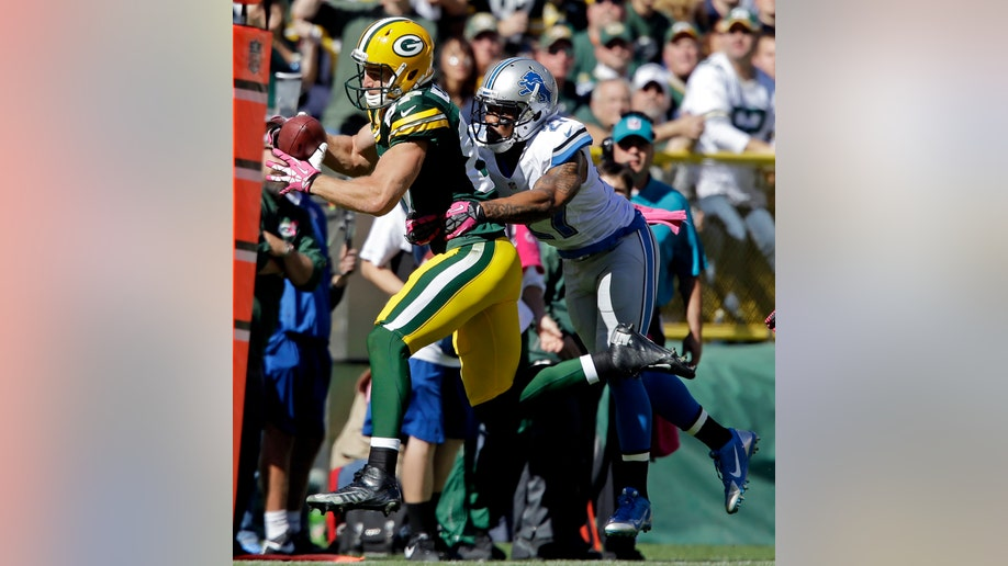 77dbdec2-Lions Packers Football