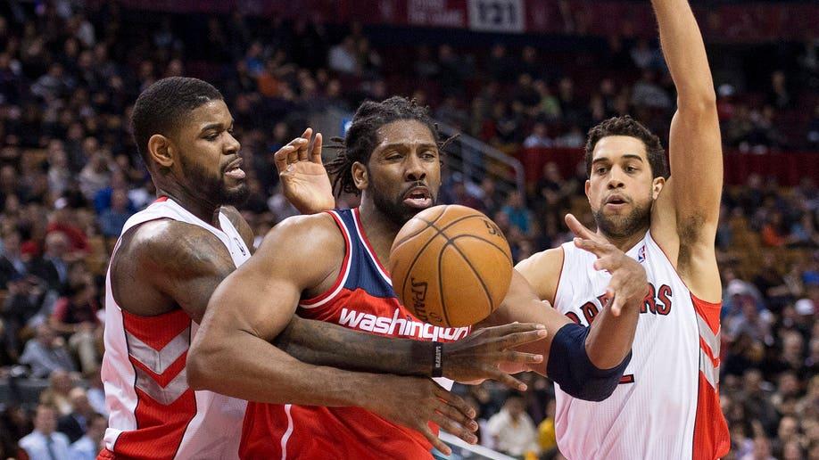 a880203e-Wizards Raptors Basketball