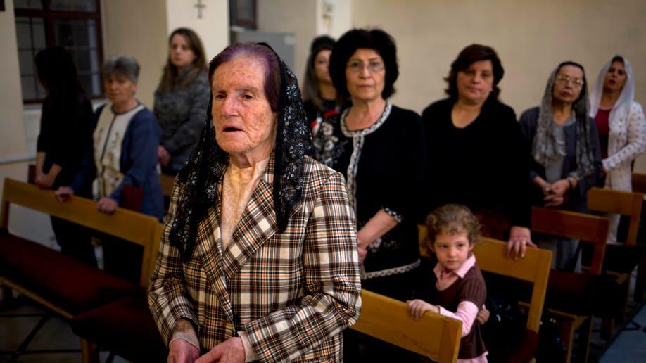 67ead833-Mideast Syria Beleaguered Christians
