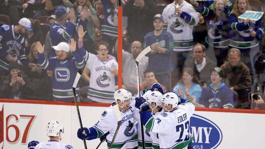 48ed496e-Canucks Senators Hockey